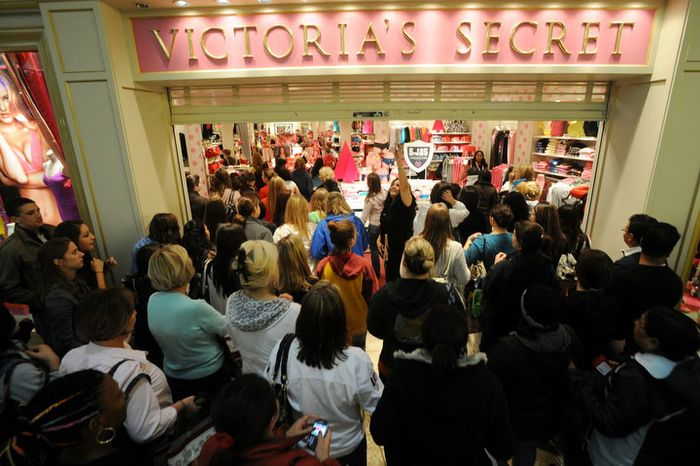 ** File ** Shoppers flood into Victoria's Secret as it opens on Black Friday, 2012. (Peter Lockley / The Washington Times)