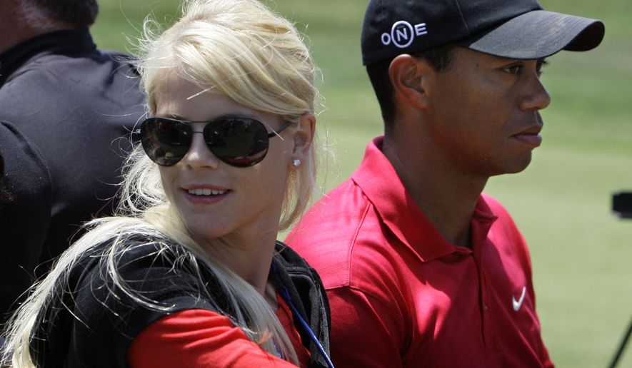 ** FILE ** Tiger Woods' wife, Elin Nordegren, rides next to Woods after winning the U.S. Open championship at Torrey Pines Golf Course on in this June 16, 2008, file photo taken in San Diego. Tiger Woods was injured early Friday Nov. 27, 2009, when he lost control of his SUV outside his Florida mansion, and a local police chief said Woods' wife used a golf club to smash out the back window to help get him out. (AP Photo/Chris Carlson, File)