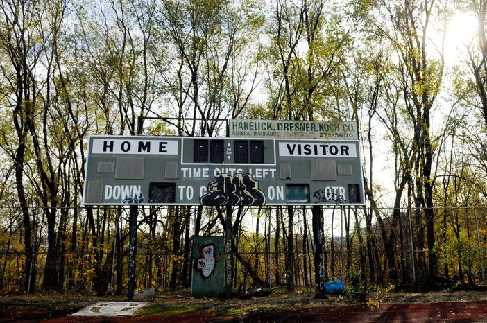 An old football scoreboard is broken and vandalized at Hinchliffe Stadium. The run-down, lonely ballpark was once a place of great community pride during the years of the Negro Leagues. (Rod Lamkey Jr./The Washington Times)