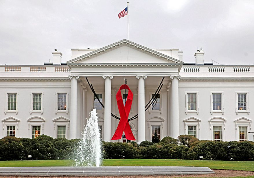 ** FILE ** A World AIDS Day ribbon is seen on the North Portico of the White House in Washington on Monday, Nov. 30, 2009. (AP Photo/Charles Dharapak)