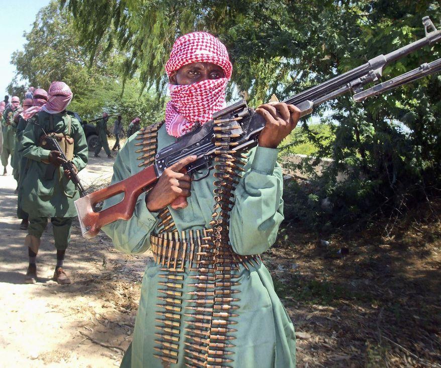 Members of the al-Shabab terrorist militia undergo training at a camp outside Mogadishu, Somalia, on Nov. 4, 2009. (Associated Press) ** FILE **