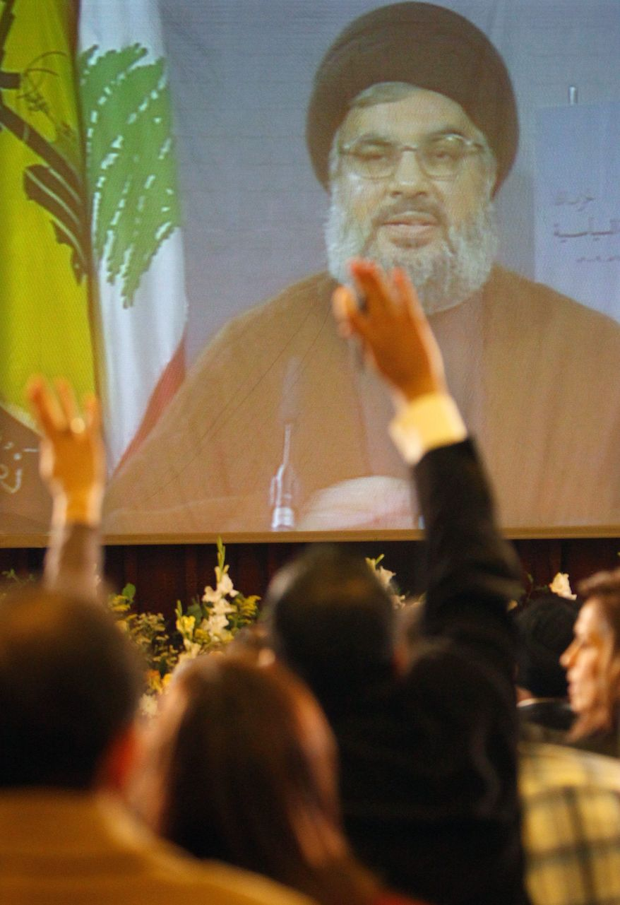 """Hezbollah leader Sheik Hassan Nasrallah says via video link Monday that """"armed struggle"""" was the only way to regain Arab lands from Israel. (Associated Press)"""