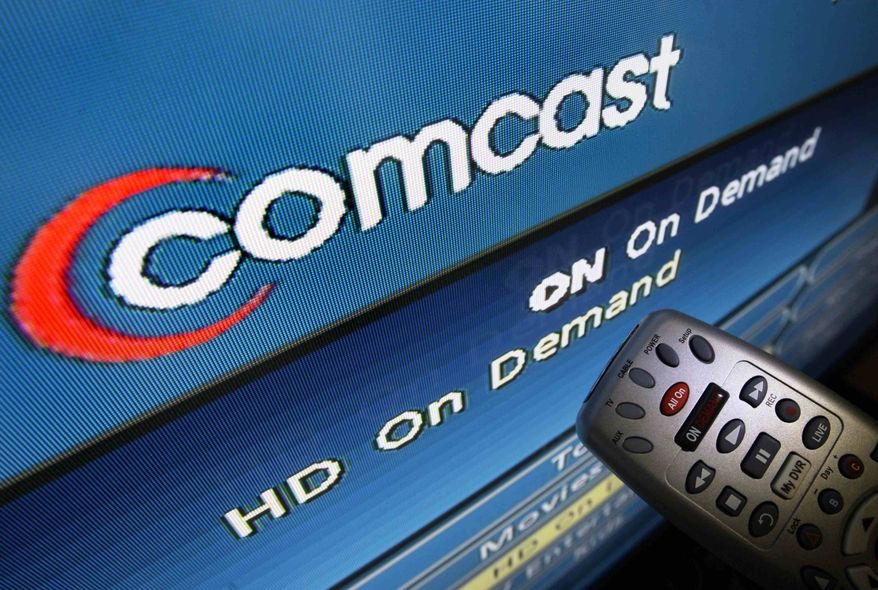 ** FILE ** In this Aug. 6, 2009, file photo, the Comcast logo is displayed on a TV set in North Andover, Mass.  (AP Photo/Elise Amendola, File)