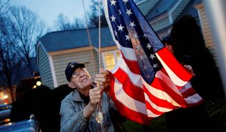 ASSOCIATED PRESS Retired Army Col. Van T. Barfoot, a World War II veteran and one of the nation's oldest Medal of Honor winners, raises the American flag on a 21-foot flagpole daily at sunrise and retires it at sunset in front of his suburban Richmond home - much to the chagrin of his local homeowners association.