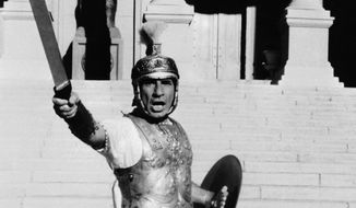"""Actor-producer-director Mel Brooks strikes a heroic pose in the Roman Empire scene from his film, """"History of the World, Part I."""" (AP Photo)"""