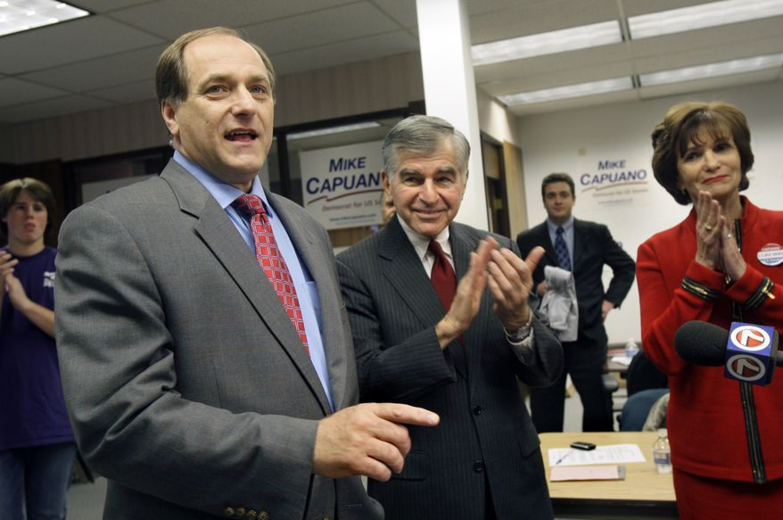 ** FILE ** Then-Democratic senatorial hopeful Rep. Michael Capuano, left, speaks to volunteers at his campaign headquarters in Worcester, Mass., Monday, Dec. 7, 2009 while former Mass. Gov. Michael Dukakis applauds with his wife, Kitty. (Associated Press)