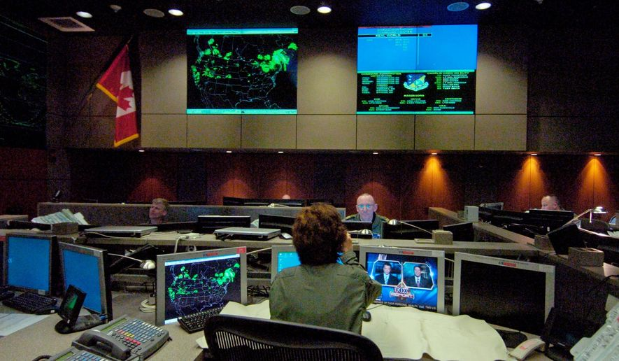 The Charlie crew, made up of U.S. and Canadian military personnel, work the night shift on Jan. 18, 2006, at the NORAD command center in Cheyenne Mountain, Colo. (AP Photo/Denver Post, John Epperson) ** FILE **