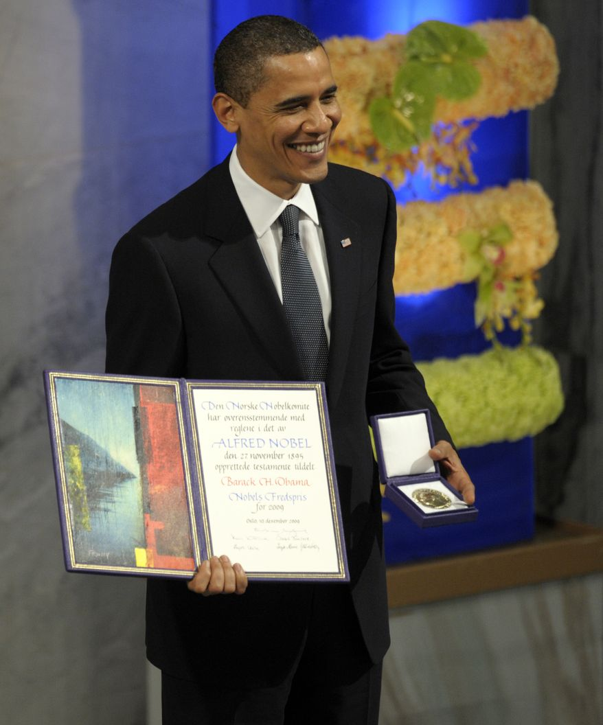 US President Barack Obama receives the Nobel Peace Prize during a ceremony in the Main Hall of Oslo City Hall in Oslo, Norway, Thursday, Dec. 10, 2009. (AP Photo/Susan Walsh)