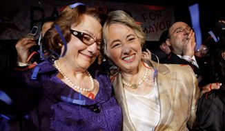 ASSOCIATED PRESS Houston Mayor-elect Annise Parker (right) celebrates her win with partner Kathy Hubbard on Saturday after defeating former city attorney Gene Locke to become the city's first openly gay mayor.