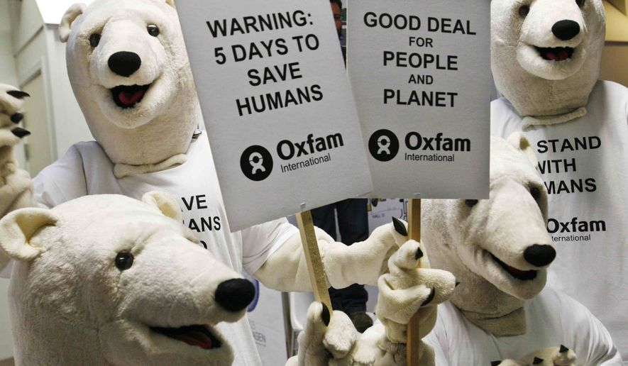 Activists dressed as polar bears stage a protest at the U.N. Climate Summit in Copenhagen on Monday, Dec. 14, 2009, on behalf of humans who are being hit hard by climate change. (AP Photo/Heribert Proepper)