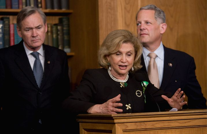 **FILE** Democratic Reps. Carolyn Maloney (center), of New York, Dennis Moore, (left) of Kansas, and Steve Israel, of New York, speak during a March 17, 2009, news conference on Capitol Hill in Washington to discuss AIG. (Associated Press)