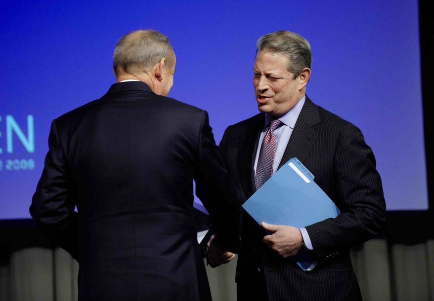 Former U.S. vice president and president candidate, Al Gore, right, shakes hands with UN climate head, Yvo de Boer, before speaking, at the Climate Summit, in Copenhagen Tuesday, Dec. 15, 2009. (AP Photo/Tariq Mikkel Khan/Polfoto)