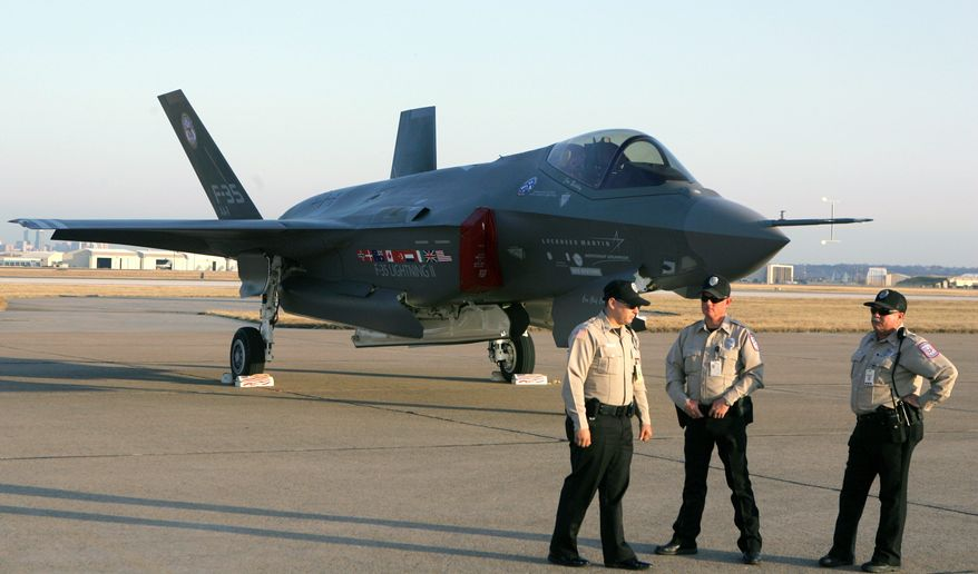 Lockheed Martin Corp. security personnel guard the F-35 Joint Strike Fighter, a workhorse aircraft for the Navy, Air Force and Marines, which received the funding President Obama requested, as well as $465 million for an alternate engine the Pentagon does not want. (Associated Press)