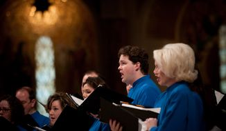The Basilica choir performs during a Christmas day mass at the Basilica of the National Shrine in NW Washington D.C., Friday, December 25, 2009.