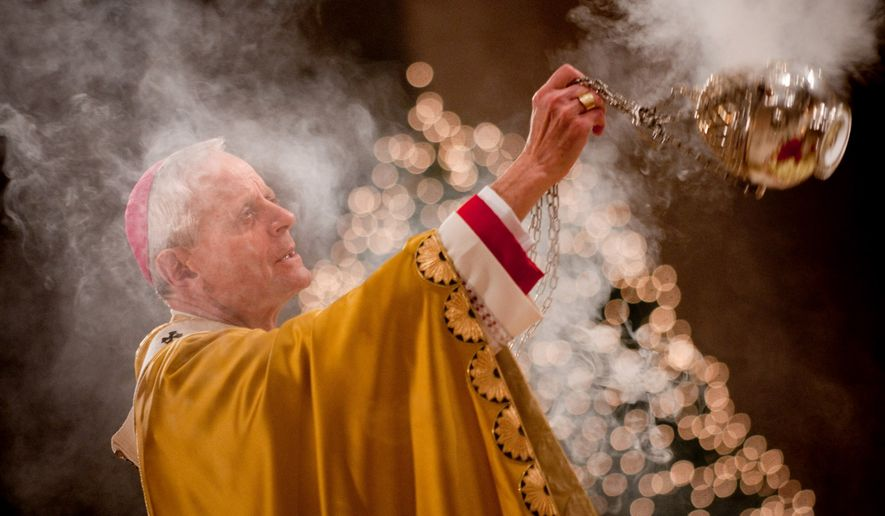 Archbishop of Washington Donald W. Wuerl celebrates Christmas Day Mass at the Basilica of the National Shrine of the Immaculate Conception in Washington in 2009.