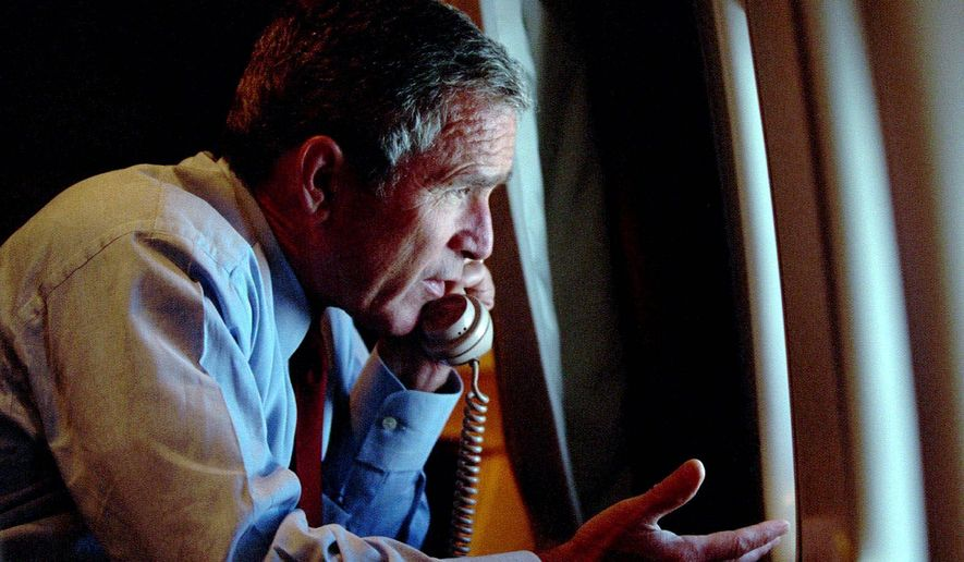 President Bush speaks to Vice President Dick Cheney by phone aboard Air Force One after departing Offutt Air Force Base in Nebraska on Sept. 11, 2001. (AP Photo)
