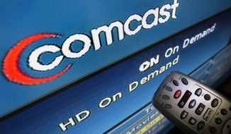 ** FILE ** In this Aug. 6, 2009, file photo, the Comcast logo is displayed on a TV set in North Andover, Mass. As the nation's biggest pay-TV provider, Comcast Corp., prepares to take control of NBC, it has not signaled any plans to reorganize the broadcast network. (AP Photo/Elise Amendola, File)