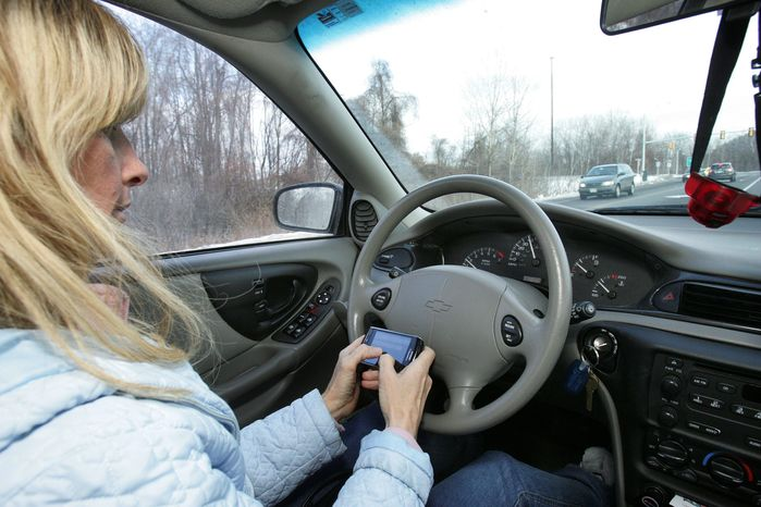 **FILE** Tina Derby sends text messages while driving in Concord, N.H. (Associated Press)