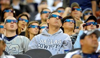 **FILE** Sports fans watch their game in 3-D. (Associated Press)