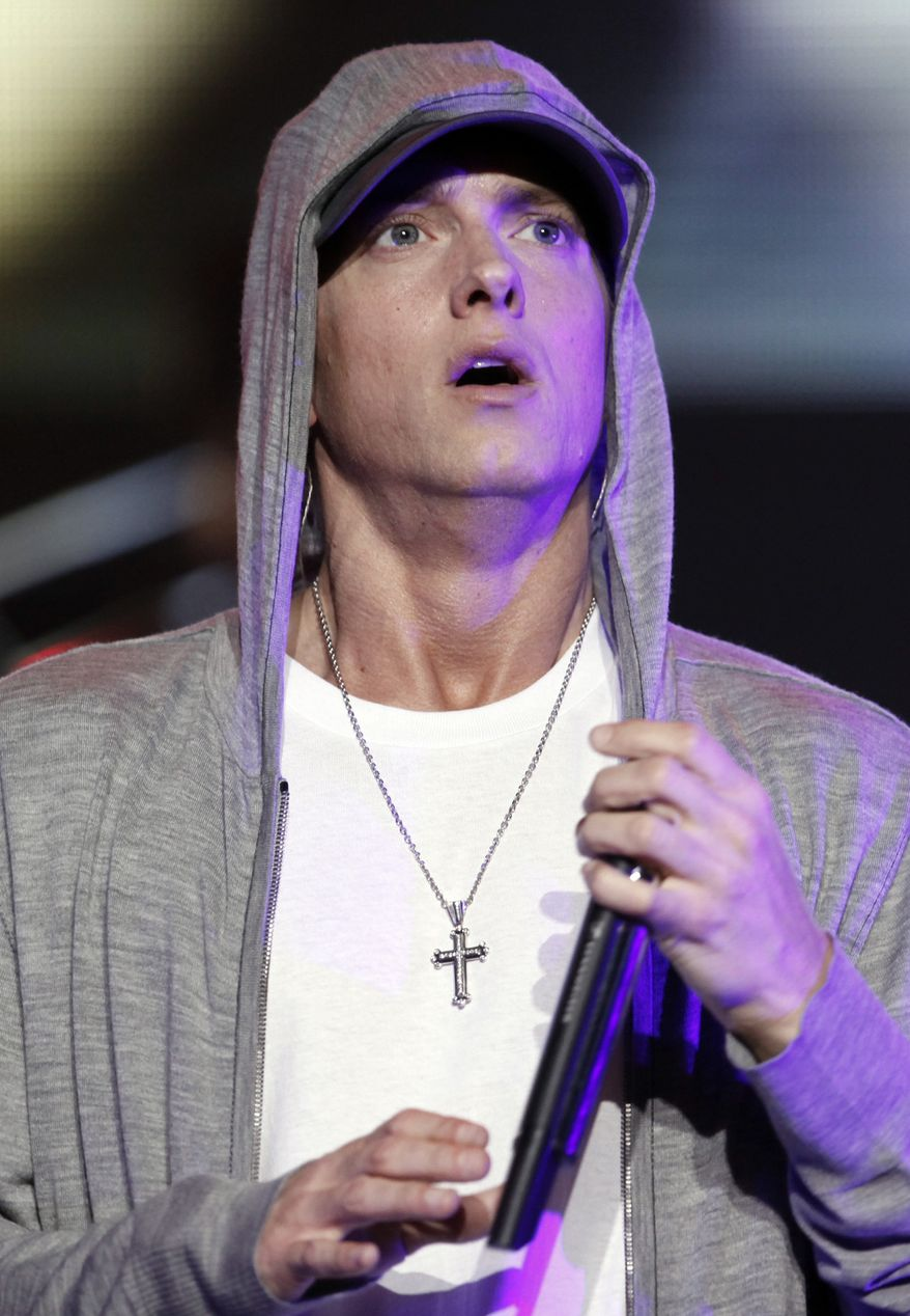"""** FILE ** Rapper Eminem performs at a concert celebrating the launch of the video game """"DJ Hero"""" in Los Angeles on in this June 1, 2009, file photo. Elton John said Saturday, Jan. 2, 2010, that he has been helping American rapper Eminen fight drug problems for more than a year. (AP Photo/Matt Sayles, File)"""