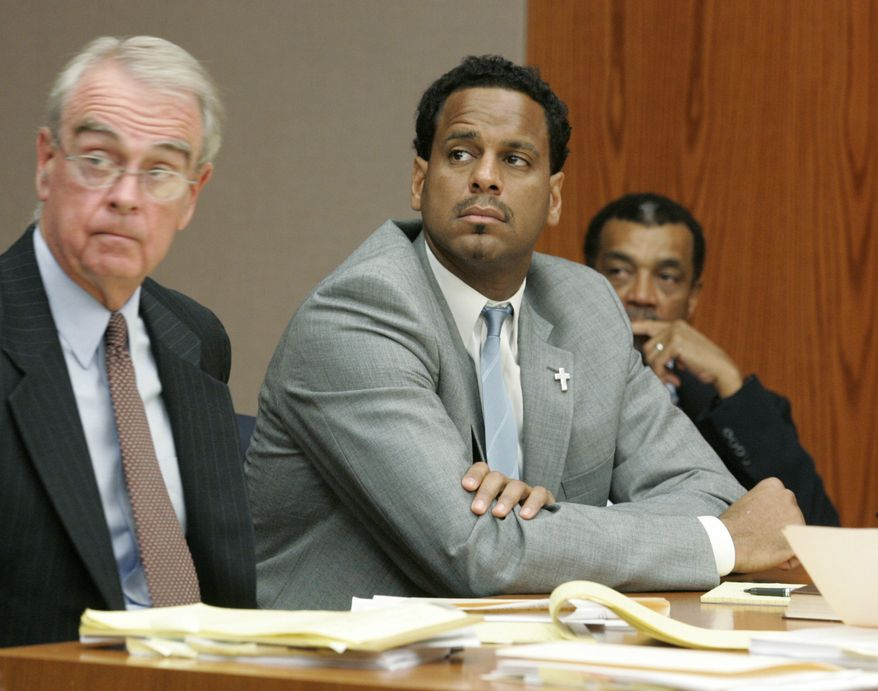 This Aug. 31 file photo shows former NBA player Jayson Williams (center) flanked by attorneys Joseph Hayden (left) and Billy Martin during a hearing in State Superior Court in Somerville, N.J. Williams struck a tree with his SUV on Tuesday in New York after veering off an exit, suffering minor injuries. Police said he may have been drinking before the crash. (Associated Press)