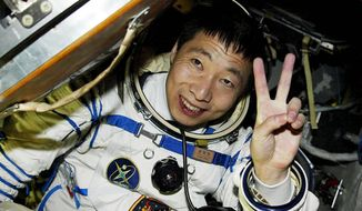 China's first astronaut, Yang Liwei, was jubilant after the capsule door was opened after his 21-hour space flight in October 2003. China could put someone on the moon within a decade.