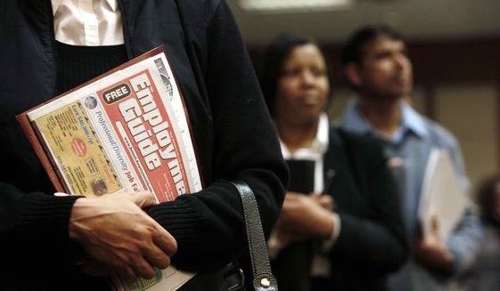 In this Nov. 4, 2009 file photo, a Detroit woman holds a Employment Guide standing in line while attending a job fair in Livonia, Mich. (AP Photo/Paul Sancya, File) **FILE**