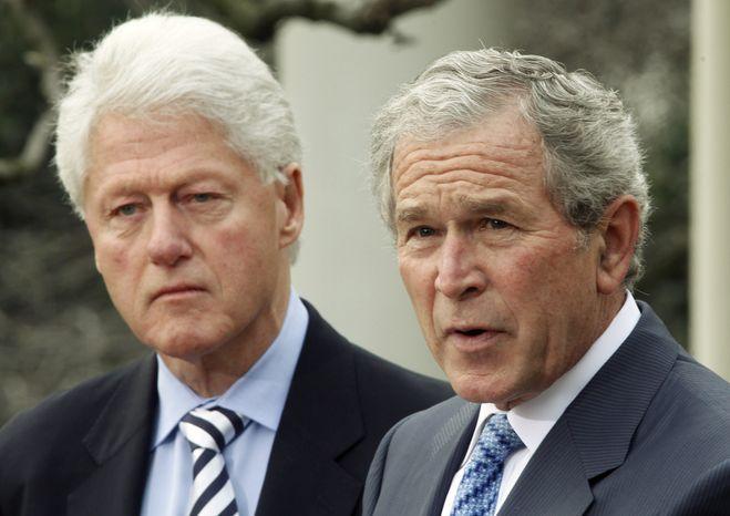 **FILE** Former President Bill Clinton (left) listens to former President George W. Bush speak on Saturday, Jan. 16, 2010, in the Rose Garden of the White House in Washington. (AP Photo/Ron Edmonds)