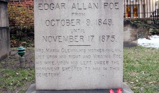 ** FILE ** The original grave of Edgar Allen Poe in Baltimore is shown with a bottle of cognac and roses left by a mysterious visitor on Saturday, Jan. 19, 2008. (AP Photo/Rob Carr, File)