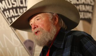 Charlie Daniels talks with reporters after being awarded a medallion at the Medallion Ceremony at the 2009 Musicians Hall of Fame awards show at the Schermerhorn Symphony Center in Nashville, Tenn. (Associated Press/File)