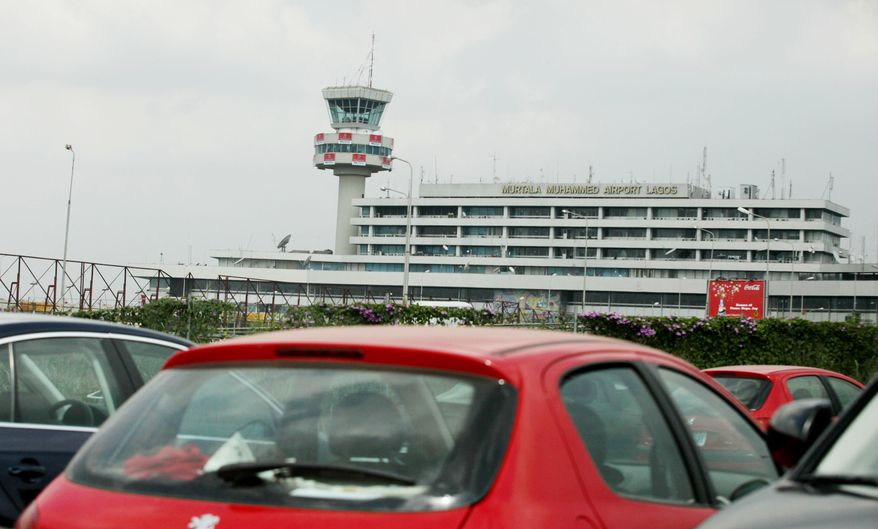 **FILE** Cars are seen parked outside Murtala Mohammed airport in Lagos, Nigeria, on Dec. 26, 2009. Northwest Airlines passenger Umar Farouk Abdulmutallab, a 23-year-old Nigerian claiming to be acting on orders from al Qaeda, set off an explosive device on a Christmas Day flight in a failed terrorist attack on the plane as it was landing in Detroit. The suspect boarded in Nigeria and went through Amsterdam en route to Detroit.