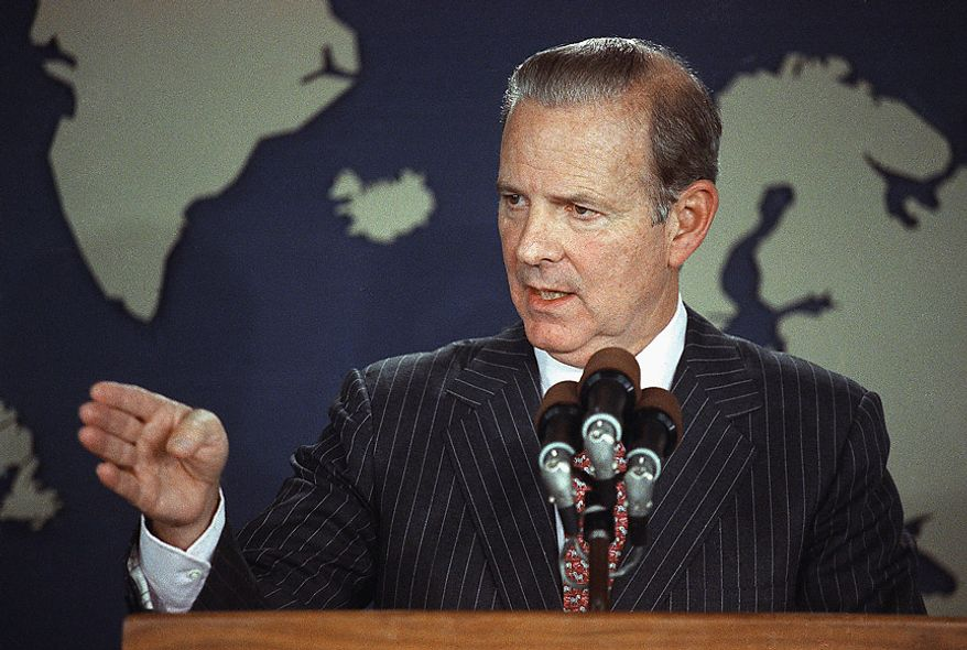 ** FILE ** Secretary of State James Baker speaks at a State Department press conference concerning U.S. troop movements in Panama, Washington, Wednesday, Dec. 20, 1989. (AP Photo/Doug Mills)