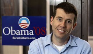 ** FILE ** David Plouffe, who led President Barack Obama's winning campaign, stands in the 2008 presidential race, in Obama's Chicago campaign headquarters, May 10, 2007. (Associated Press)