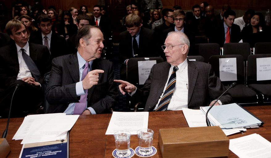 ** FILE ** Former Gov. Thomas H. Keane (left), New Jersey Republican, and former Rep. Lee H. Hamilton, Indiana Democrat, speak before a Senate panel in 2010. (Associated Press)
