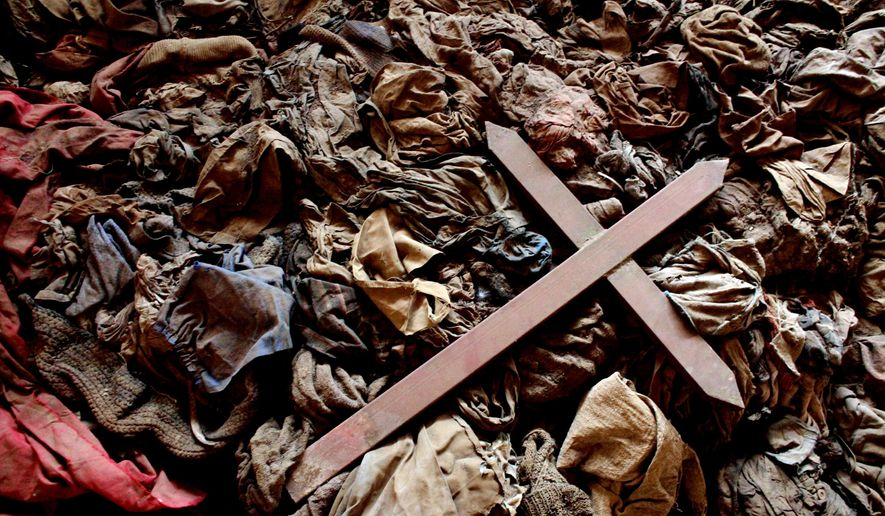 A wooden cross lies in Nyamata, Rwanda. (Associated Press)