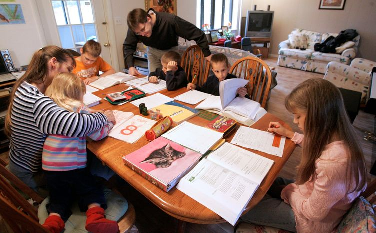 Uwe Romeike and his wife, Hannelore, worked with their children at home in Morristown, Tenn., last year. The German family was granted political asylum in the U.S. on grounds they faced persecution in Germany for home schooling. (Associated Press)
