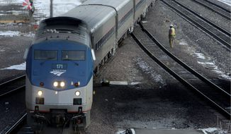 ** FILE ** An Amtrak train switches tracks after arriving in St. Louis from Chicago on in January 2010. (Associated Press)
