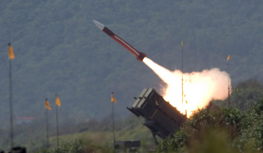 ** FILE ** A U.S.-made Patriot missile is launched during in Ilan County, 49 miles west of Taipei, Taiwan., on July 20, 2006.  (Associated Press) ** FILE **