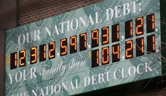 **FILE** The National Debt Clock is shown in New York on Feb. 1, 2010. (Associated Press)