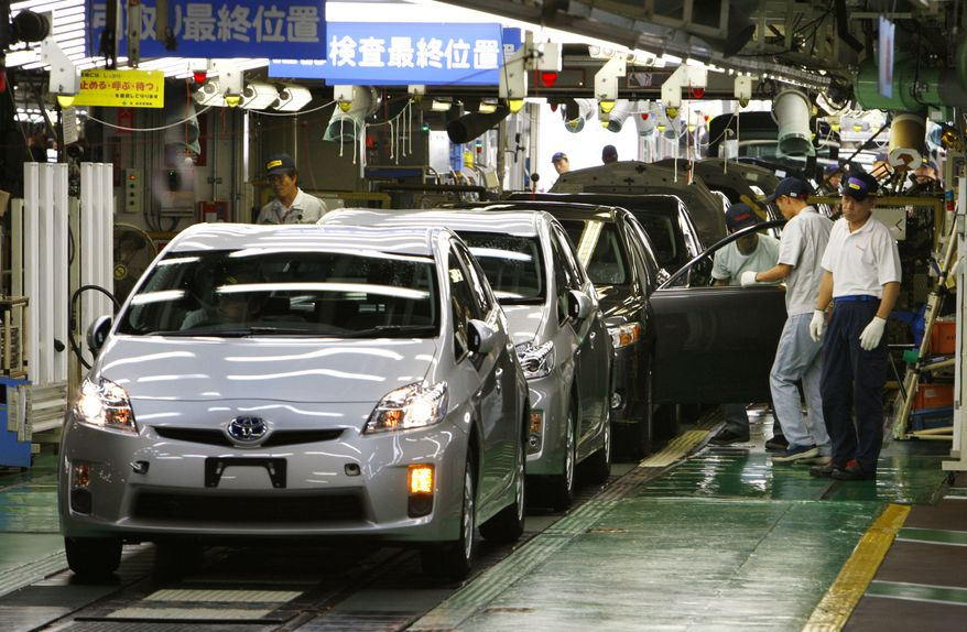 ** FILE ** In this June 5, 2009, photo, workers give the final checkup to new Prius hybrid vehicles at Toyota's Tsutsumi Plant in Toyota, Japan. The Japanese government said on Wednesday, Feb. 3, 2010, it had received 14 complaints in Japan about brake problems with the popular hybrid. (AP Photo/Shizuo Kambayashi, File)