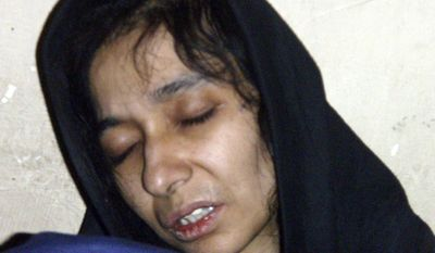 ** FILE ** Aafia Siddiqui is seen in the custody of the Counter Terrorism Department of Ghazni province in Ghazni City, Afghanistan, on July 17, 2008. The U.S.-trained Pakistani scientist was convicted by a jury on Wednesday, Feb. 3, 2010, of charges she tried to kill Americans while she was detained in Afghanistan. (AP Photo/File)