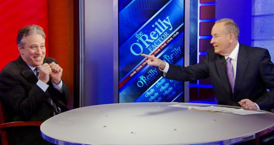 """** FILE ** """"The O'Reilly Factor"""" host Bill O'Reilly points across the table at """"The Daily Show"""" host Jon Stewart on the set of Mr. O'Reilly's show on Wednesday, Feb. 3, 2010, in New York. (AP Photo/Fox News Channel)"""