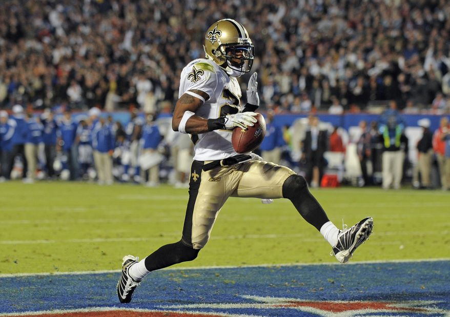 New Orleans Saints cornerback Tracy Porter (22) scores a 74-yard touchdown after intercepting against the Indianapolis Colts during the second half of the Saints' 31-17 victory in Super Bowl XLIV in Miami. (Associated Press)