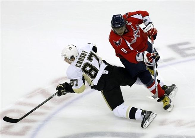 Washington Capitals' Alex Ovechkin (8), of Russia, runs into Pittsburgh Penguins' Sidney Crosby (87) during the second period of an NHL hockey game Sunday, Feb. 7, 2010, in Washington. (AP Photo/Luis M. Alvarez)
