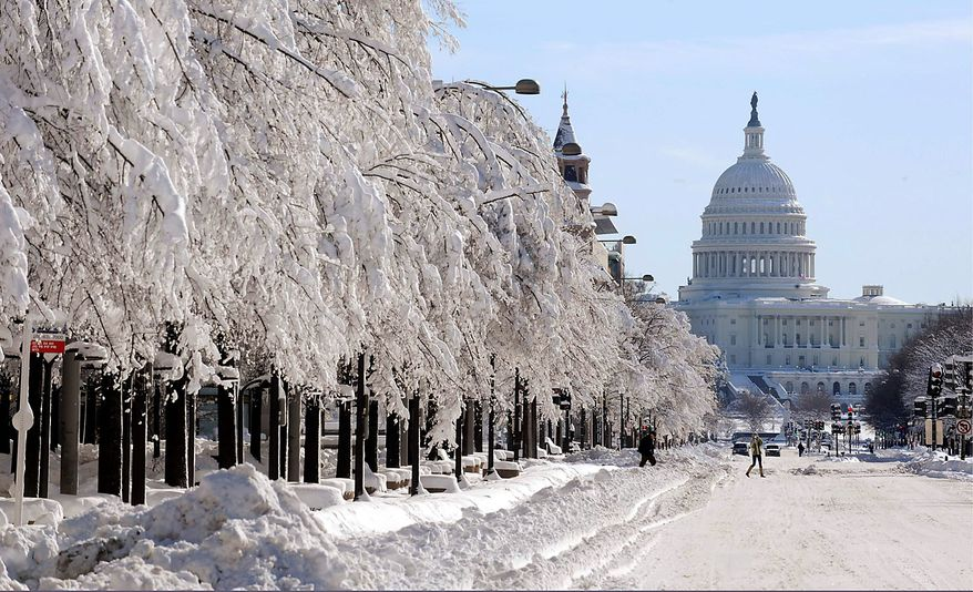 Icy trees line Pennsylvania Avenue with plowed snow banked at its sides near the U.S. Capitol in Washington Sunday, Feb.  7, 2010, after the nation's capital was hit by a blizzard. (AP Photo/Susan Walsh)