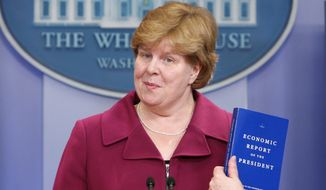Council of Economic Advisers Chair Christina Romer holds up a copy of the Economic Report that she will deliver to President Obama, as she briefs reporters at the White House in Washington, Thursday, Feb. 11, 2010. (AP Photo/Charles Dharapak)