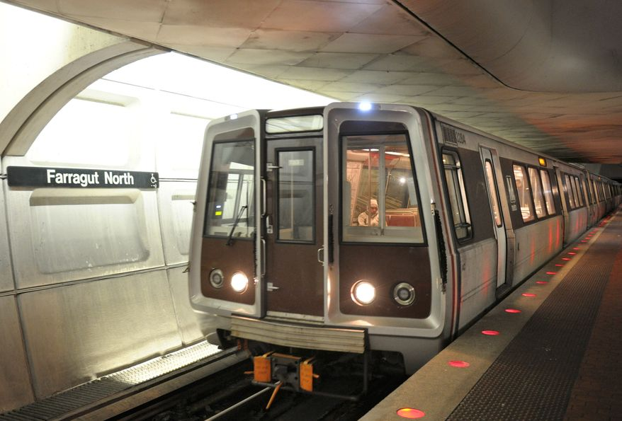 ** FILE ** A Red Line train passes through the Farragut North Metro station in Washington. (Associated Press)
