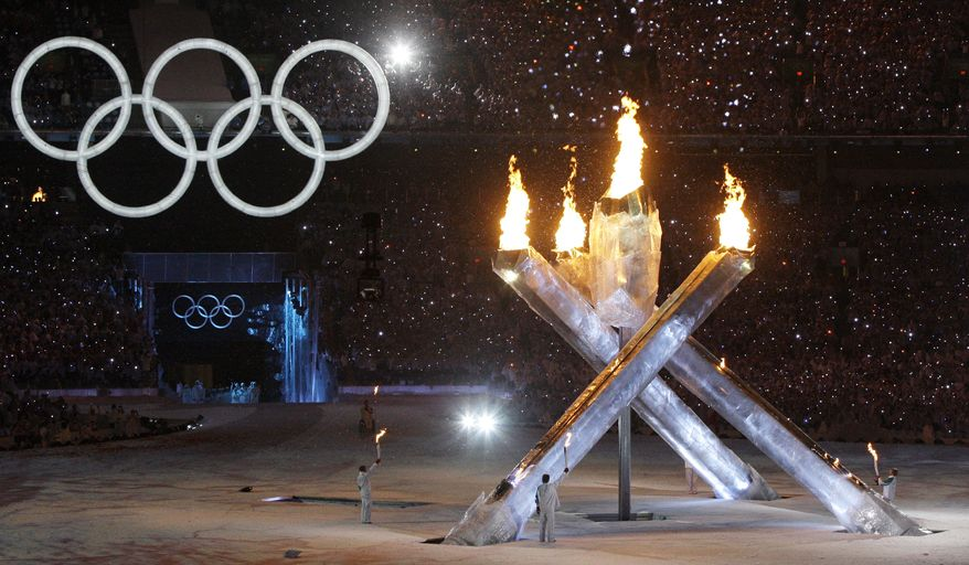 **FILE** The Olympic torch is lit Friday during the opening ceremony for the Vancouver 2010 Olympics in Vancouver, British Columbia. (Associated Press)
