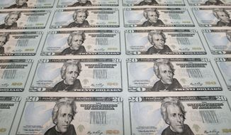 Newly printed $20 notes are seen at the Bureau of Engraving and Printing in Washington. (AP Photo/J. Scott Applewhite) ** FILE **