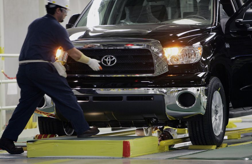 ** FILE ** In this Nov. 15, 2006, file photo, a Toyota Tundra is inspected during the final stages of assembly at the Toyota Manufacturing Texas, Inc. in San Antonio. (AP Photo/Eric Gay, file)